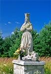 Figura Matki Bożej w Szewni Górnej - ufundowana z wdzięczości za uratowanie życia w wypadku samochodowym 20-XII-1986, przez księdza Andrzeja Jabłońskiego w 1986 roku