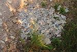 Zasypany eternitem wybój na leśnej drodze Narol-Huta Szumy