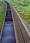 LHS - jak widać po tym leju w wagonie - ładunek ucieka przez dziurę w podłodze wagonu