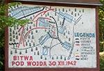Tablica przy pomniku w Wojdzie